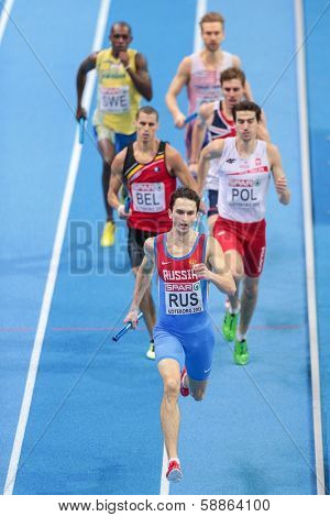 GOTHENBURG, SWEDEN - MARCH 3 Yury Trambovetsky (Russia) and his team place 2nd in the men's 4x400m finals during the European Athletics Indoor Championship on March 3, 2013 in Gothenburg, Sweden.