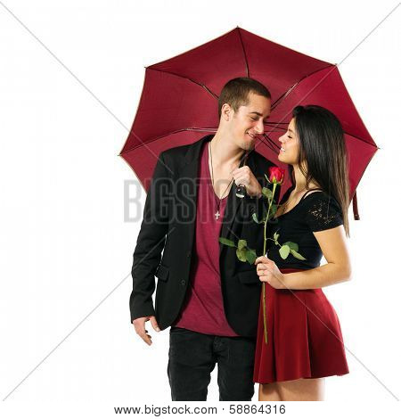 Young couple in love with red umbrella and flower over white background
