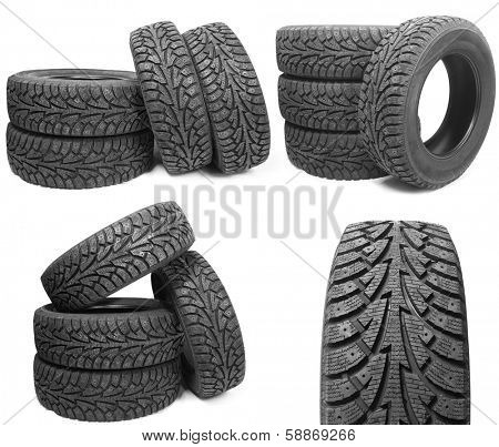set of stack of four new black tyres for winter car on white background