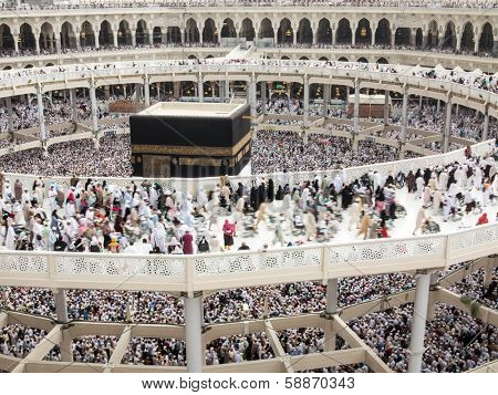 Kaaba the Holy mosque in Mecca with Muslim people pilgrims of Hajj praying in crowd (newest and very rare images of Holiest mosque after latest widening 2013-3014)
