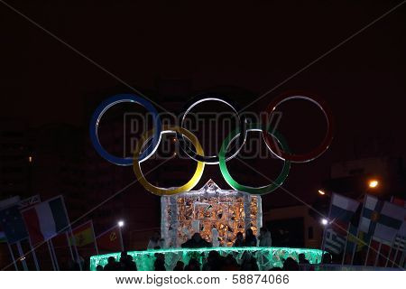 Perm, Russia - Jan 11, 2014: Illuminated Symbol Of Olympic Games In Ice Town At Evening, Created In