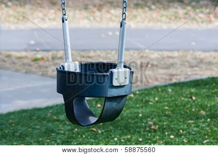 Close Up Of Swings On Empty Playground