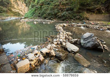 Environmental pollution in the Himalayas. Garbage in the water of Bagmati river.