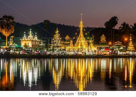 The Shan/Burmese style Wat Chong Klang and Wat Chong Kham temples reflected in the Nong Jong Kham pond in Mae Hong Son, Northern Thailand