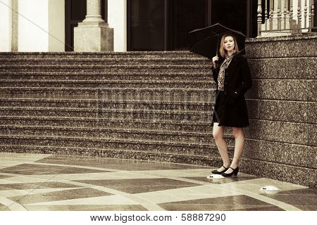 Woman with umbrella in the rain