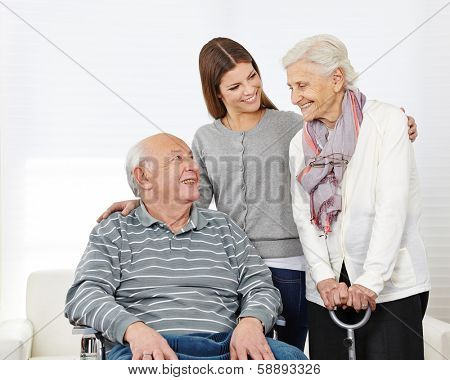 Happy family with smiling senior couple at home