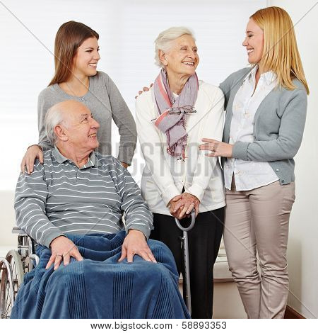 Family with mother and daughter and two senior citizens at home