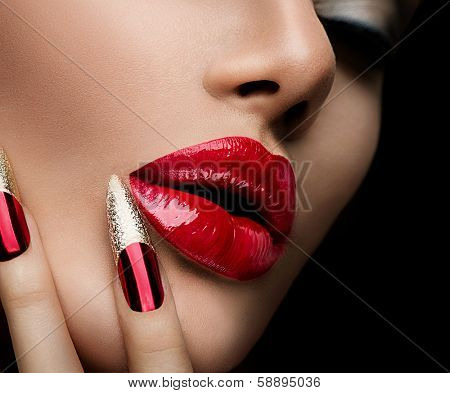 Beauty Concept. Fashion Model Girl Face isolated on Black Background. Makeup and Manicure. Red Long Nails and Red Glossy Lips. Sensual Mouth. Beautiful Sexy Lips. Fashion. Make-up. Perfect Skin