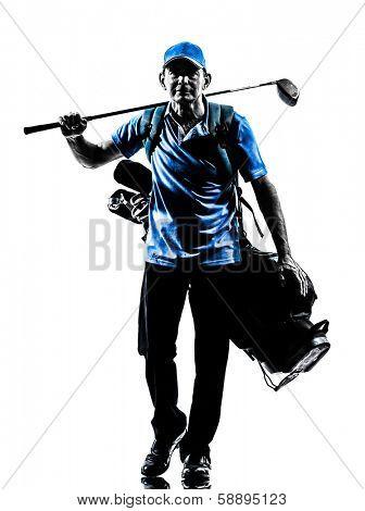 one man golfer golfing golf bag walking in silhouette studio isolated on white background