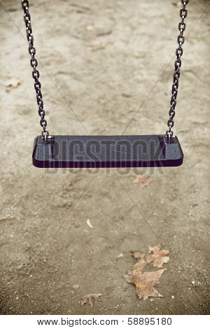 Closeup of a child swing with unfocused background