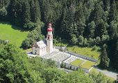Austrian Church And Graveyard In The Alps
