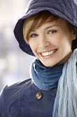 stock photo of early 20s  - Closeup portrait of happy young woman early spring clothing - JPG