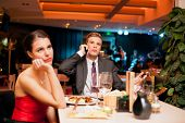 stock photo of lonely woman  - Young man making an boring  expression gesture on a bad dating - JPG