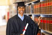 stock photo of laws-of-attraction  - handsome african university law school graduate - JPG