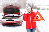 pic of breakdown  - A picture of a young woman having a problem with a car on a winter road - JPG