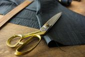 foto of tailoring  - Measuring and cutting textile or fine cloth - JPG