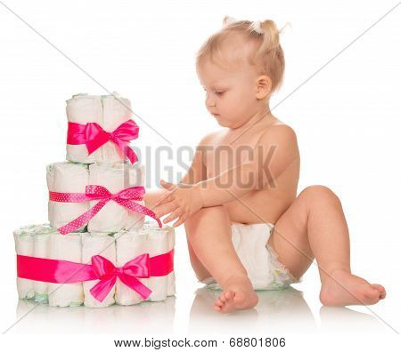 Baby girl with heap of diapers