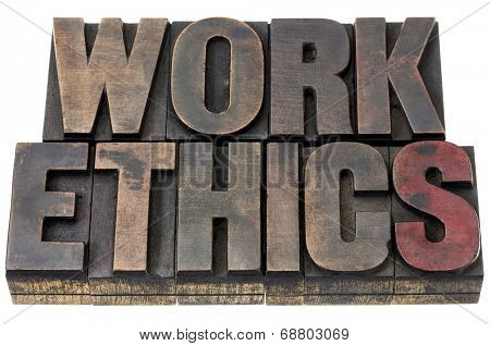 work ethics - isolated word in vintage letterpress wood type with ink patina