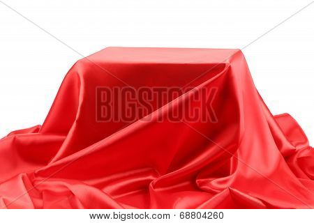 Red silk drape.