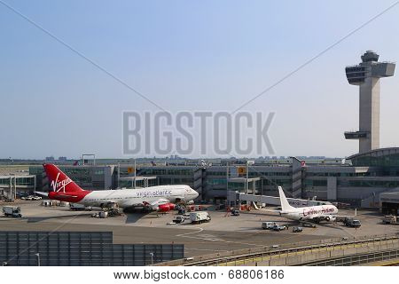 Air Traffic Control Tower and Terminal 4 with Virgin Atlantic Boeing 747 at JFK Airport