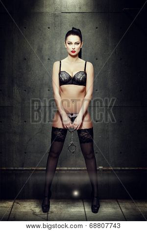 Woman In Black Lingerie Holding Handcuffs