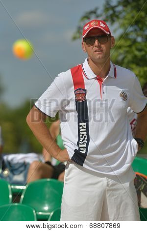MOSCOW, RUSSIA - JULY 19, 2014: Captain of team Russia Stanislav Zaichenko watch the match Russia-Venezuela during ITF Beach Tennis World Team Championship. Russia won 2-1