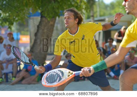 MOSCOW, RUSSIA - JULY 20, 2014: Vinicius Font of Brazil in the final match against Italy during ITF Beach Tennis World Team Championship. Italy won 2-0