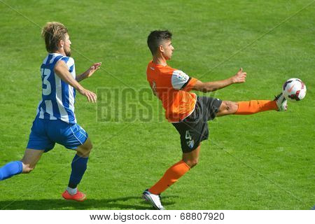 MOSCOW, RUSSIA - JULY 21, 2014: A. Portillo of Malaga, Spain (right) and S. Mihajlovic of OFK, Serbia during the Lev Yashin VTB Cup, the international tournament for U21 soccer teams. Malaga won 2-0