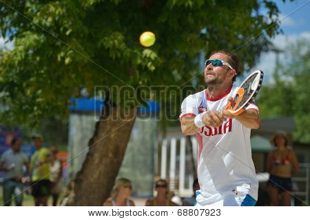 MOSCOW, RUSSIA - JULY 20, 2014: Sergey Kuptsov of Russia in the match for 3rd place against Germany during ITF Beach Tennis World Team Championship. Russia won 3-0