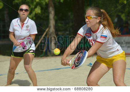 MOSCOW, RUSSIA - JULY 19, 2014: Woman double of Russia in the match against Venezuela during ITF Beach Tennis World Team Championship. Russia won 2-1