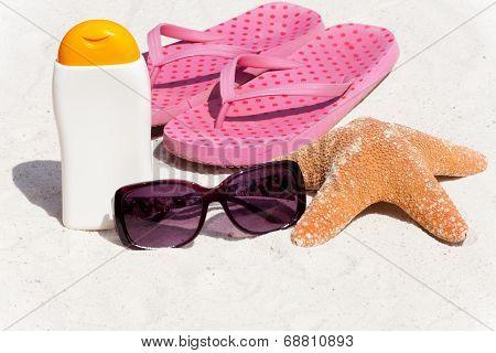 Sunscreen And Flip-flops On The Beach