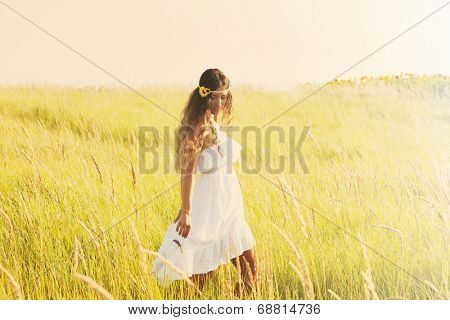 happy smiling woman in boho style clothes walk  through the field, sunny summer day, retro colors