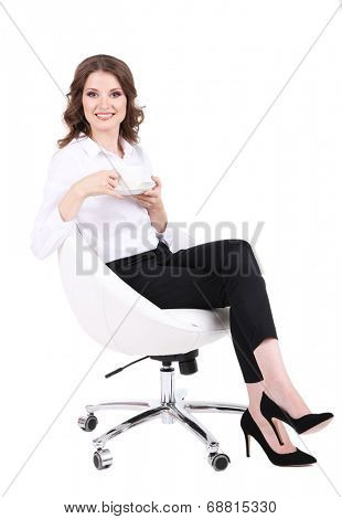 Young business woman sitting on chair with cup isolated on white