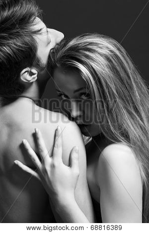 lowkey B and W portrait of a passionate couple