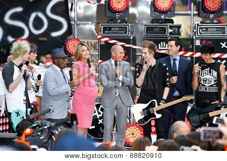NEW YORK-JUL 22: (L-R) Michael Clifford, Ashton Irwin, Al Roker, Savannah Guthrie, Matt Lauer, Luke Hemmings, Carson Daly and Calum Hood on NBC's 'Today Show' on July 22, 2014 in New York City.