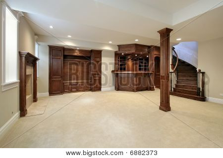 Basement With Wood Cabinetry