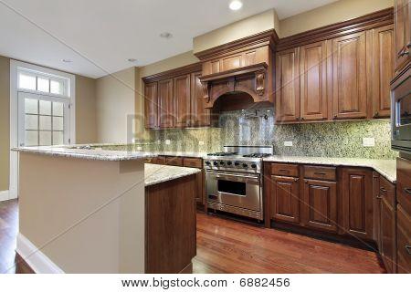 Kitchen With Granite Backsplash