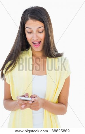 Shocked casual woman reading a text on white background