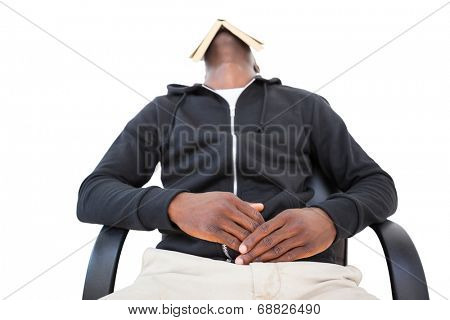 Man sleeping in swivel chair with book over face on white background
