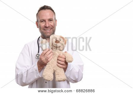 Friendly Smiling Paediatrician Holding A Teddy Bear