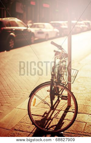 Bicycle Resting At The Street