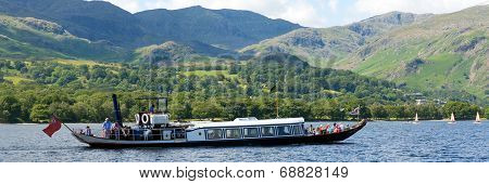 Gondola steam boat on Coniston water Lake District England uk on a hot sunny summer day