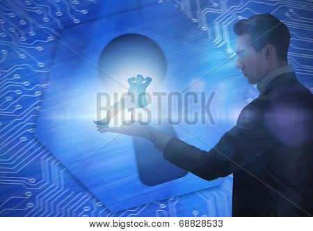 Composite image of businessman holding business man in swivel chair against keyhole graphic on blue background