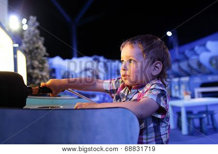 Child Playing In The Games Attraction