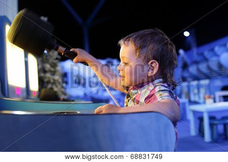 Kid Playing In The Games Attraction