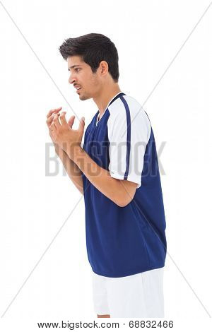 Football player feeling distraught on white background
