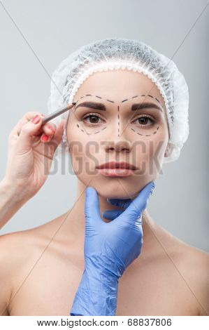 Beautiful young woman in surgical cap with perforation lines on