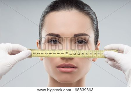 Woman head being measured by beautician hands