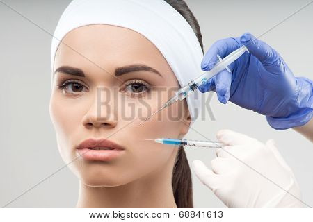 young Caucasian woman getting cosmetic injection