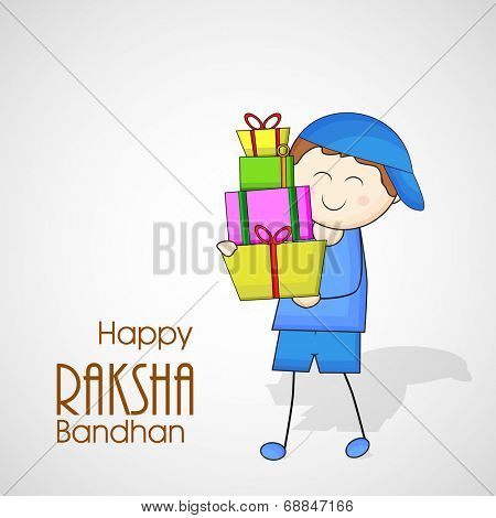 Cute little boy holding colorful gift boxes on grey background for the occasion of Raksha Bandhan festival.